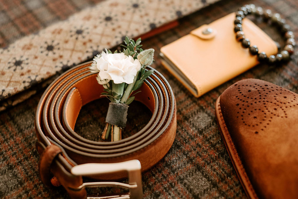 flat lay of grooms wedding day essentials